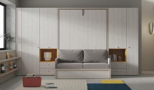Habitación diferente con cama abatible de 150 vertical con sofá y armarios