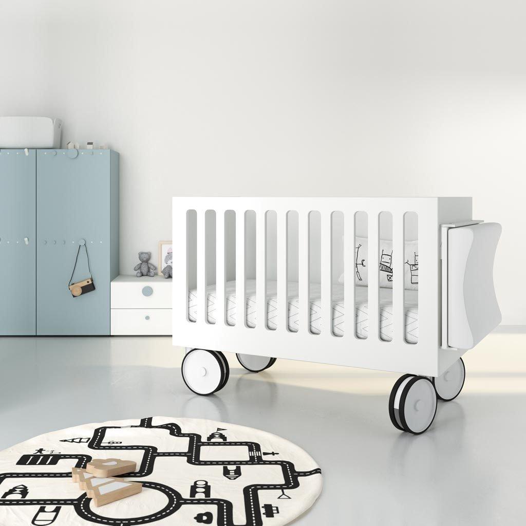 Cuna para bebe con ruedas y cambiador en color blanco