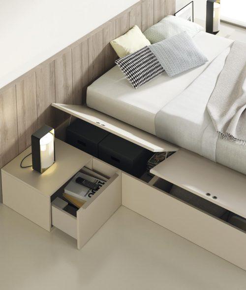 Detalle de los contenedores elevables en la cama