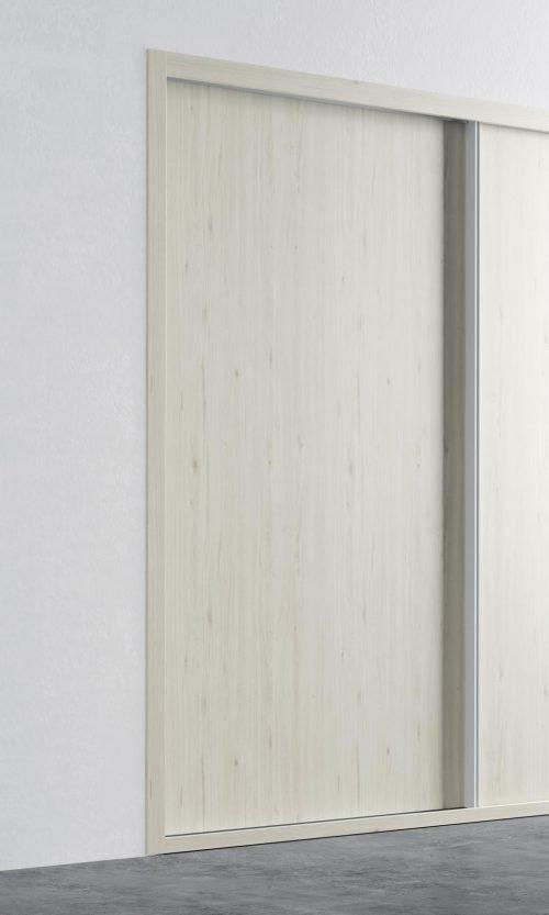 Detalle de la puerta corredera del armario empotrado en color Abeto