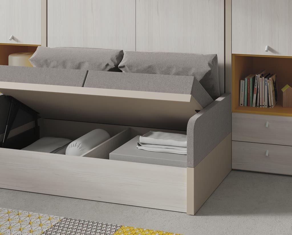Detalle del arcón bajo la cama sofá para ganar espacio en la habitación