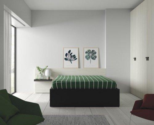 Dormitorio de adulto con cama canapé y armario de puertas batientes