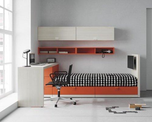 Cama nido, zona estudio, estantes y cajones con la TV integrada en el mueble ¿Se puede pedir más?