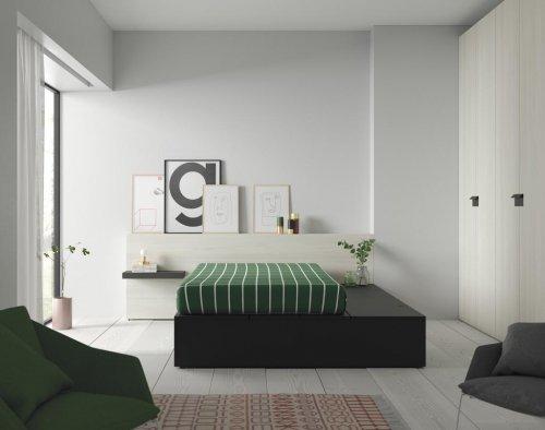 Dormitorio de adulto con grandes arcones herméticos para ganar espacio en la habitación