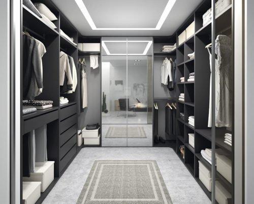 Habitación vestidor con espejo en los frentes de un armario