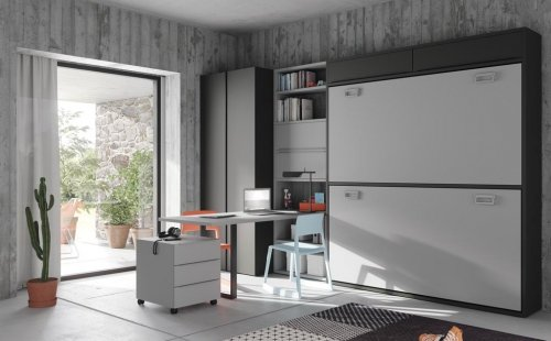Dormitorio Juvenil con una litera abatible complementada con armario, mesa estudio y estanterías