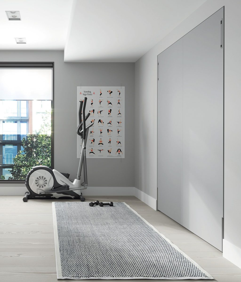 Cama abatible vertical de 190x150 cm cerrada empotrada en la pared