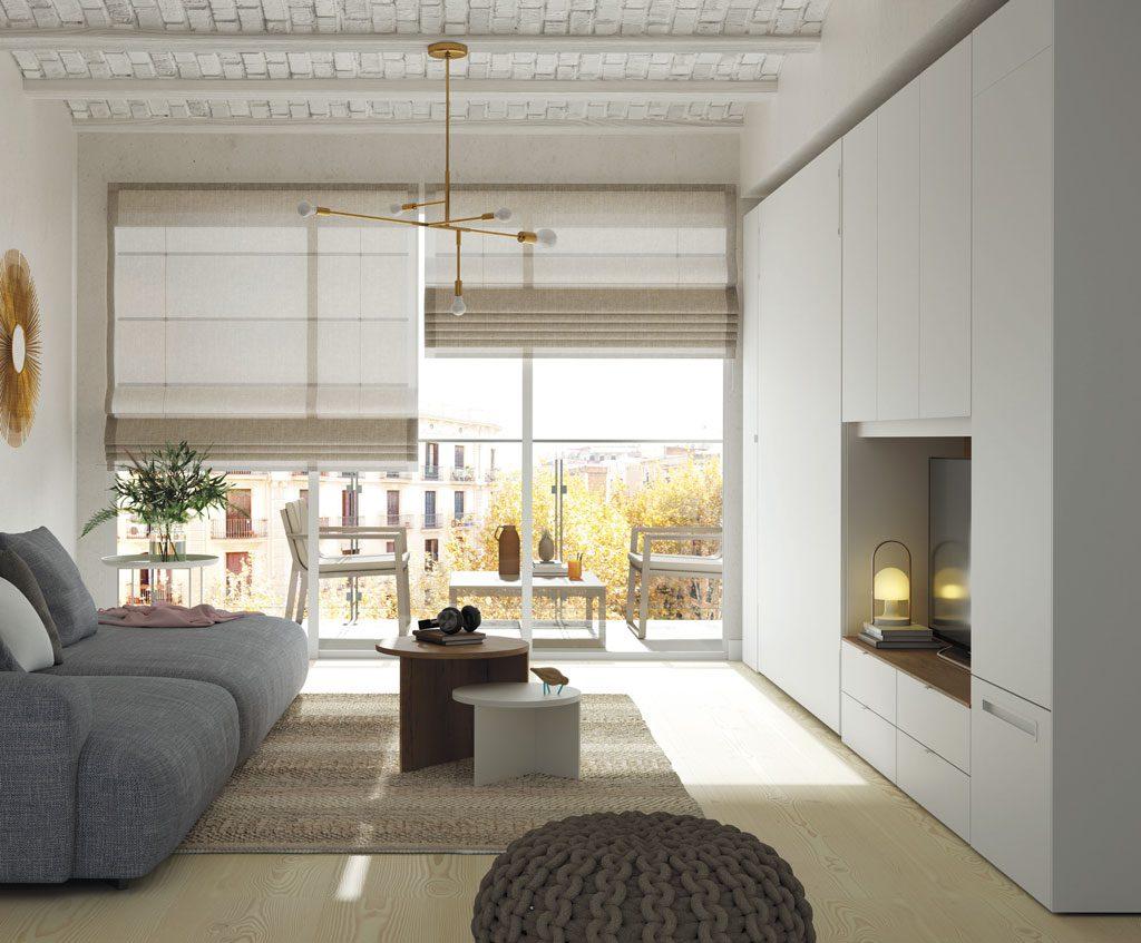Cama abatible vertical integrada en los muebles de este Loft