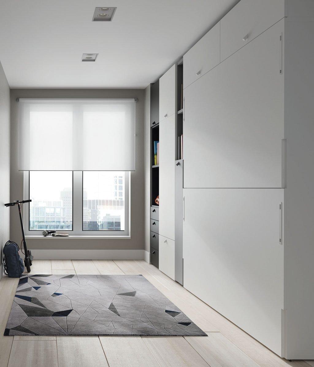 Habitación con una litera abatible integrada con el resto de muebles
